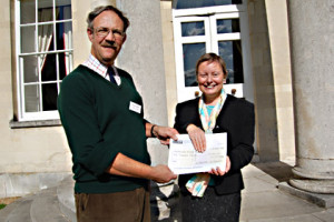 Sue Flood accepts our cheque from David Howlett