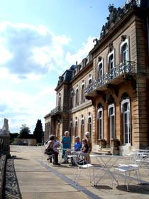 Members take tea on the south terrace