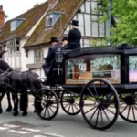 The hearse setting off