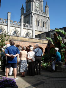 In the courtyard, our guide describes the architecture