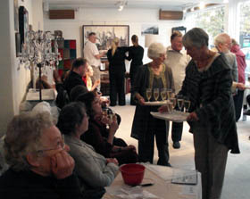 Vicki Lockyer offers drinks as Pauline Humphries (corner left) looks on