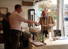 Chairman David Howlett congratulates John Lucas